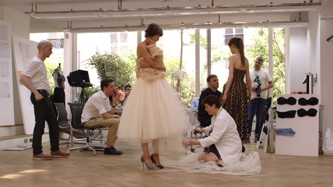 Raf Simons works on his reinterpretation of a Dior dress. Credit: CIM Productions