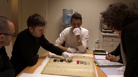 Raf Simons and Pieter Mulier review fabrics from Dior's first collection at the archives. Credit: CIM Productions